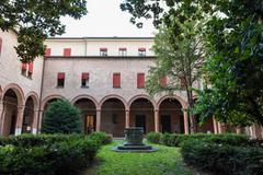 Cloister of one of the little curch in the downtown of Ferrara city - stock photo
