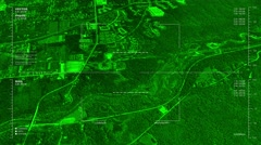 Night vision aerial  surveillance flyover of the outskirts of a rural town - stock footage