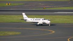Private prop plane taxies along runway Stock Footage