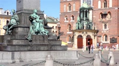 Cracow main square, Mariacki church and Adam Mickiewicz statue Stock Footage