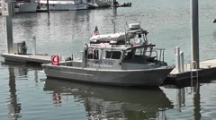 Harbor Patrol Boat With Crewman Aboard Stock Footage