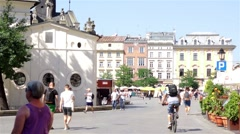 Cracow Main Square, St. Wojciech church and townhouses - stock footage