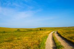 Gravel Road through Flint Hills - stock photo