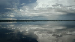 Stock Video Footage of clouds reflected in the Rio Negro