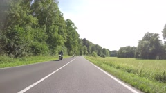 Motorbikes driving on a twisting road in germany Stock Footage