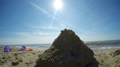 Beach Time Lapse with sandcastle and toys in foregroud Stock Footage