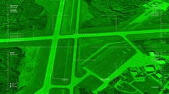 Night vision aerial  surveillance flyover of a small regional airport - stock footage