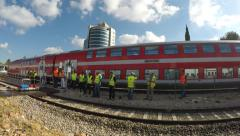 Safety inspectors stand while train the train continues to transport passengers Stock Footage