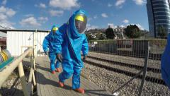 Three firefighters from Northern Israel with protective gear walk Stock Footage