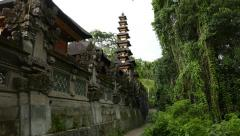 Fine tall pagoda of Balinese temple, glide moving camera outside Pura wall Stock Footage