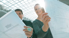 Smiling Engineers on Building Approval - stock footage