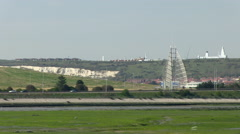 View Across Tipner Lake towards Sails of the South M275 Motorway and Portsdow Stock Footage