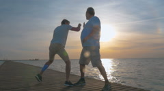 Son and Father Fighting in Joke Stock Footage