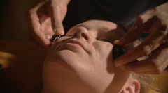 Relaxing facial massage with hot stones in beauty spa Stock Footage