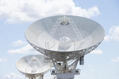 Astronomical telescope dishes at blue sky - stock photo