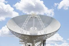 Astronomy Telescope dish with blue sunny sky Stock Photos