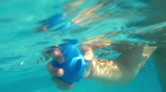 Child enjoying swimming in outdoor pool Stock Footage