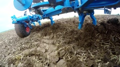 Plow of a tractor on a field Stock Footage