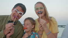 Happy family with hipster accessories outdoor Stock Footage