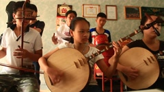Asian children playing traditional instruments,  Asia Stock Footage