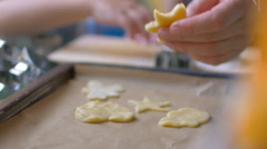 Cutouts of cookie dough on baking tray Stock Footage
