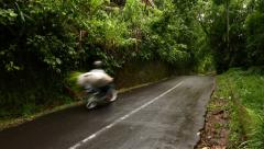Narrow road at rural hill rainforest area, motorbike run on empty way Stock Footage