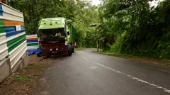 Steep road descent, tropical tangle, motorbike hoot and drive downward Stock Footage