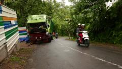 Descending road in tropical forest, motorbike ride up and down Stock Footage
