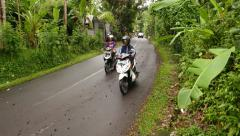 Lively traffic on rural tropical road, some Balinese village area Stock Footage