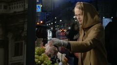 Woman buying fruit in outdoor market Stock Footage