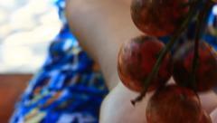 Peeling fresh fig Stock Footage