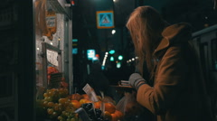 Woman Buying Fruit in Street Stall Stock Footage