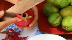 Cut and putting fresh exotic fruits on the plate Stock Footage