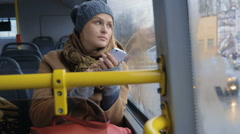 Woman with Smartphone Riding a Bus Stock Footage