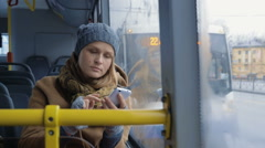 Woman passenger looking out bus window - stock footage