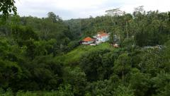 Lonely villa within deep tropical jungle on hills, Balinese foothill Stock Footage