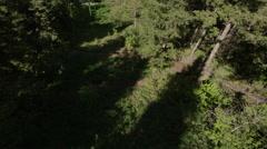 Overhead shot of mountain bikers on drit mounatin trail Stock Footage
