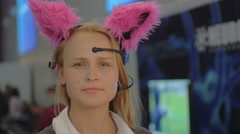 Woman in brain-controlled cat ears Stock Footage