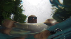 Selfie man on lazy river - underwater perspective Stock Footage