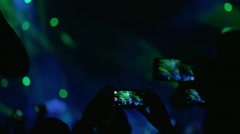 People Shooting the Performance on Smartphones Stock Footage