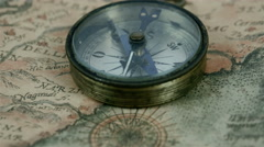 Zoom in view of the compass on the map - stock footage
