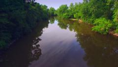 Gliding Down Mirror Smooth River With Lush Foliage Stock Footage