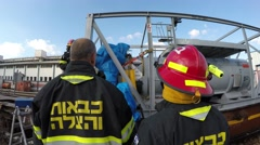 Firefighters from Northern Israel inspect their friends with protective gear Stock Footage