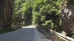 Narrow mountain road in the Rhodope Mountains, Bulgaria Stock Footage