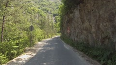 Narrow mountain road in the Rhodope Mountains, Bulgaria - stock footage