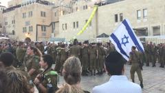Stock Video Footage of Israeli soldiers singing and dancing at the western wall