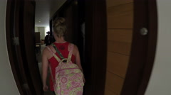 Young woman entering resort room for first time Stock Footage