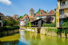 River and buildings in Salies de Bearn, France. - stock photo