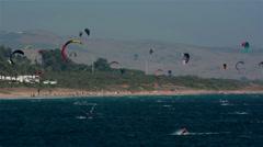 Tarifa, Spain. Crow of windsurfers and kitesurfers Stock Footage