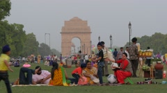 Family sitting in park at India Gate,New Delhi,India Stock Footage